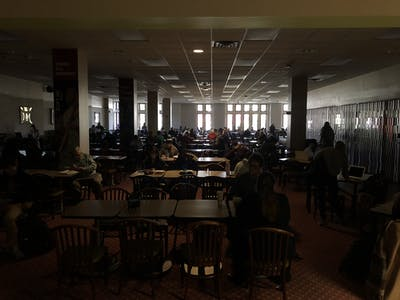 Students sit during a power outage Nov. 8 at the Indiana Memorial Union. The power outage affected many buildings across campus.