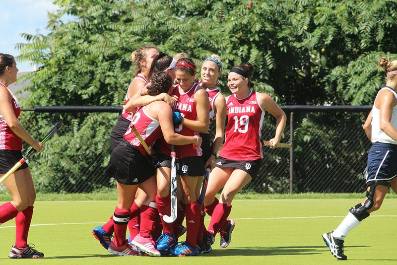 The IU Women's Field hockey team celebrates their first goal in their game on Sept. 11 against the University of New Hampshire at the IU Field Hockey Complex.