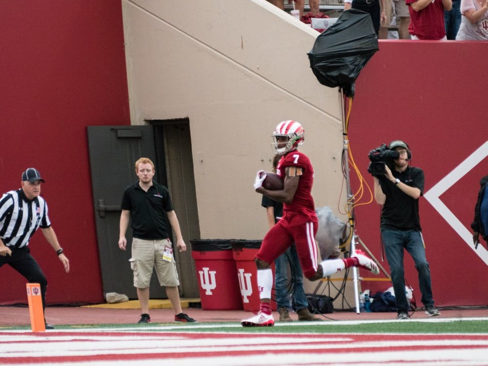 Redshirt freshman wide receiver Taysir Mack reaches the end zone after receiving a pass from freshman quarterback Peyton Ramsey during the game against Charleston Southern on Oct. 7 at Memorial Stadium. Mack is one of three IU players who recently announced their transfer destinations.