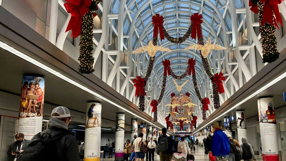 Thanksgiving travelers walk through Terminal 3 on Nov. 25 at O'Hare International Airport in Chicago.