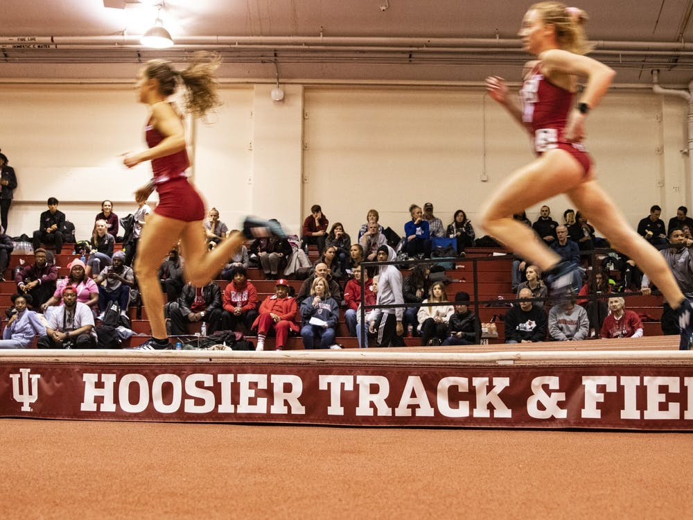 IU track and field athletes sprint in the 800-meter dash Feb. 14, 2020, in Gladstein Fieldhouse. IU's men and women's track and field teams placed first at the Gladstein Invitational this weekend.