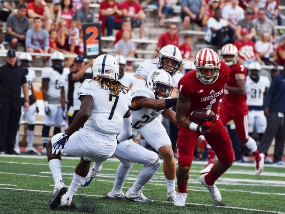 Senior wide receiver Simmie Cobbs Jr. attempts to run with the ball before being tackled by Charleston Southern during the Oct. 7 game at Memorial Stadium. IU (3-2) plays No. 17 Michigan (4-1) today in Bloomington.