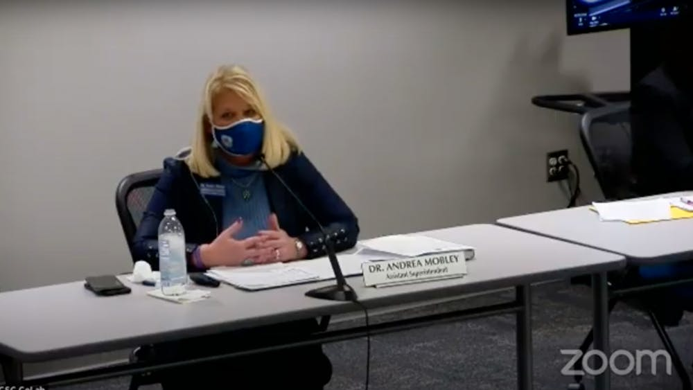 Assistant Superintendent Andrea Mobley discusses current COVID-19 information with the Monroe County Community School Corporation Board of Trustees on Tuesday night over Zoom.