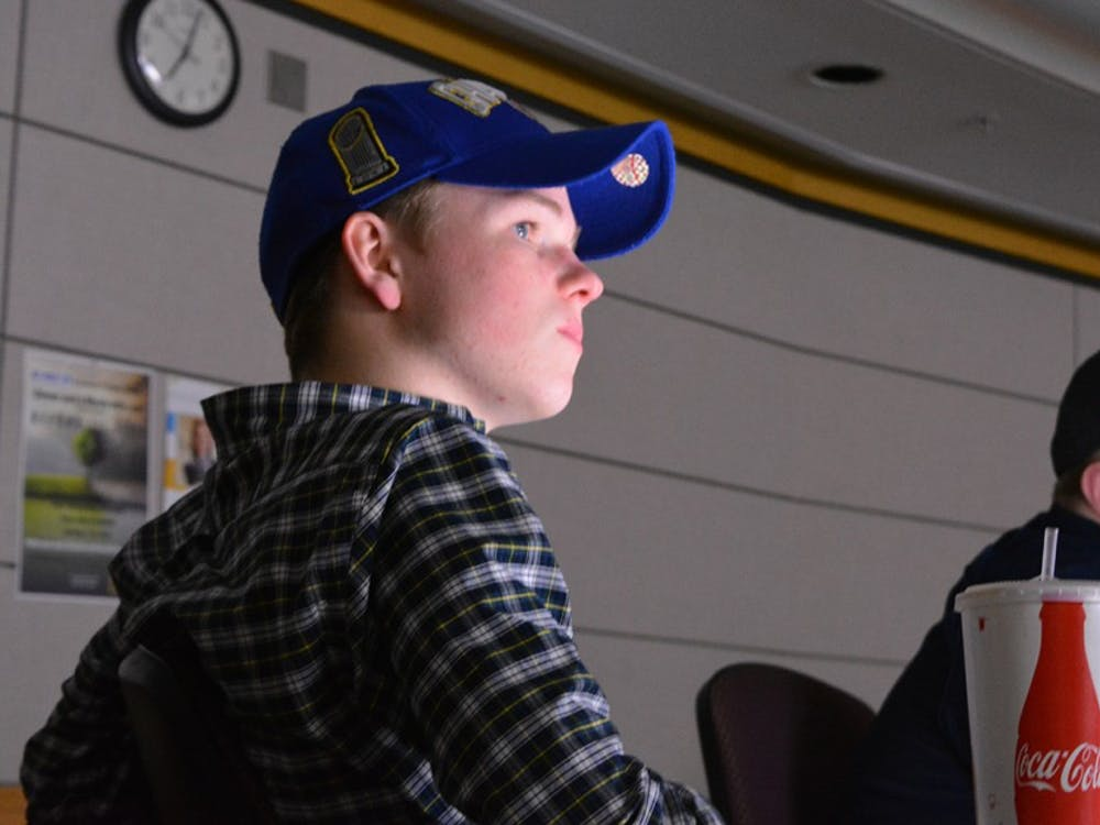 Freshman Brendan Blankfield, left, and freshman Charles Frank, watch highlights from the Feb. 7 healthcare debate. They joined the College Republicans at IU for a discussion about the future of healthcare in the United States.