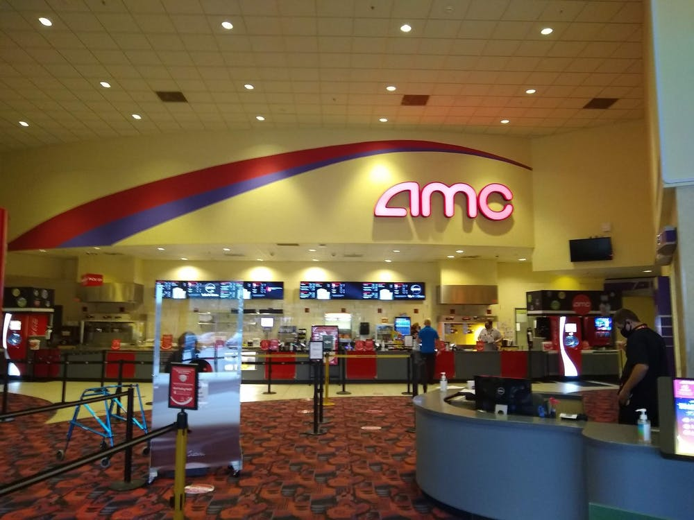 Patrons walk through the concessions area of the AMC Classic Bloomington 12. Movie theaters across the country have reopened in recent weeks after making changes to deal with the coronavirus pandemic.