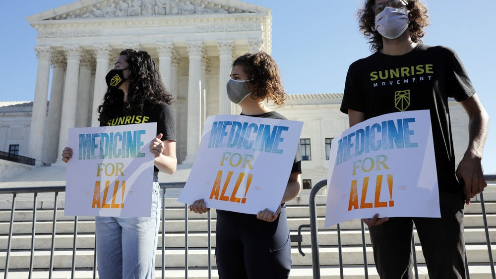 Demonstrators rally outside the U.S. Supreme Court in Washington before an argument on the Affordable Care Act on Tuesday. Supreme Court justices sounded ready to uphold the Affordable Care Act for the third time and reject the latest challenge from its conservative critics, including President Donald Trump, during Tuesday's hearings.