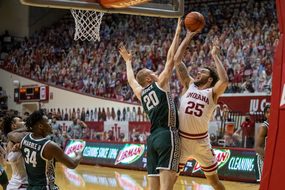 <p>Redshirt junior forward Race Thompson takes a shot in the paint Saturday at Simon Skjodt Assembly Hall. Thompson finished the game with 15 points, six rebounds and seven steals during IU&#x27;s loss to Michigan State.</p>