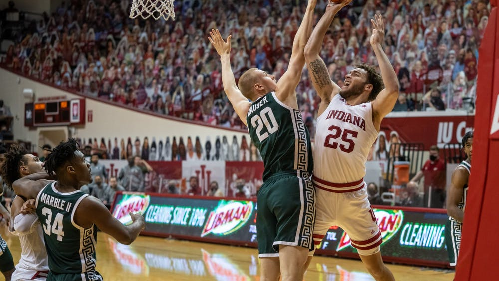 Redshirt junior forward Race Thompson takes a shot in the paint Saturday at Simon Skjodt Assembly Hall. Thompson finished the game with 15 points, six rebounds and seven steals during IU's loss to Michigan State.