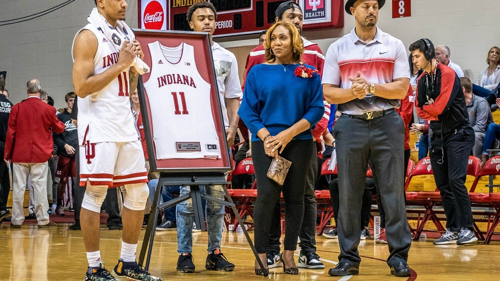 Senior guard Devonte Green standswith his family March 7 in Simon Skjodt Assembly Hall while being recognized for senior night. Wisconsin defeated IU 60-56.
