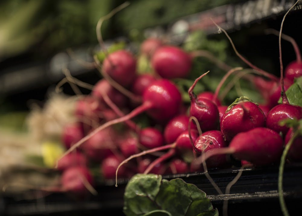 <p>Radishes sit in the fresh vegetable section of Bloomingfoods Sunday. The IU Food Project focuses on educating undergraduates on nutrition, and it raises awareness regarding food-related social, environmental, economic and cultural issues.&nbsp;</p>