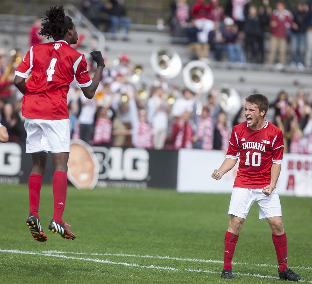 Femi Hollinger-Janzen celebrates his goal with teammate Tanner Thompson on Sunday at Bill Armstrong Stadium.