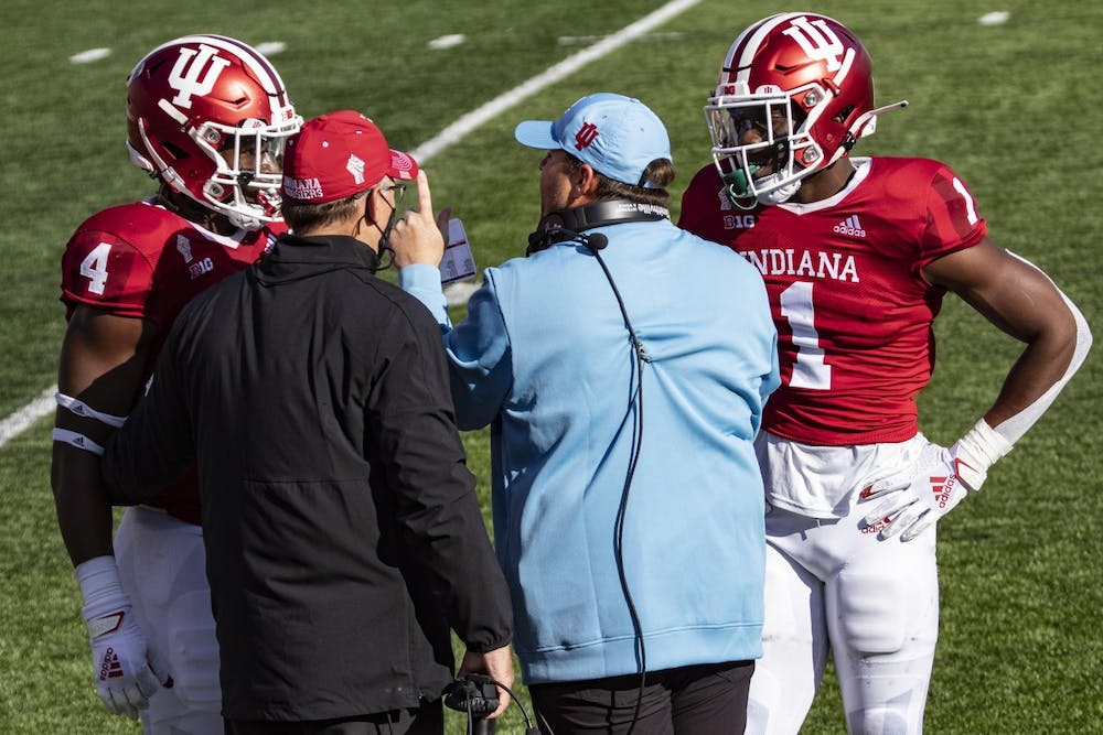<p>Head coach Tom Allen and defensive coordinator Kane Wommack talk to junior defensive back Devon Matthews and junior linebacker Cam Jones on Oct. 24 in Memorial Stadium. Wommack has been hired as the head coach at the University of South Alabama.</p>