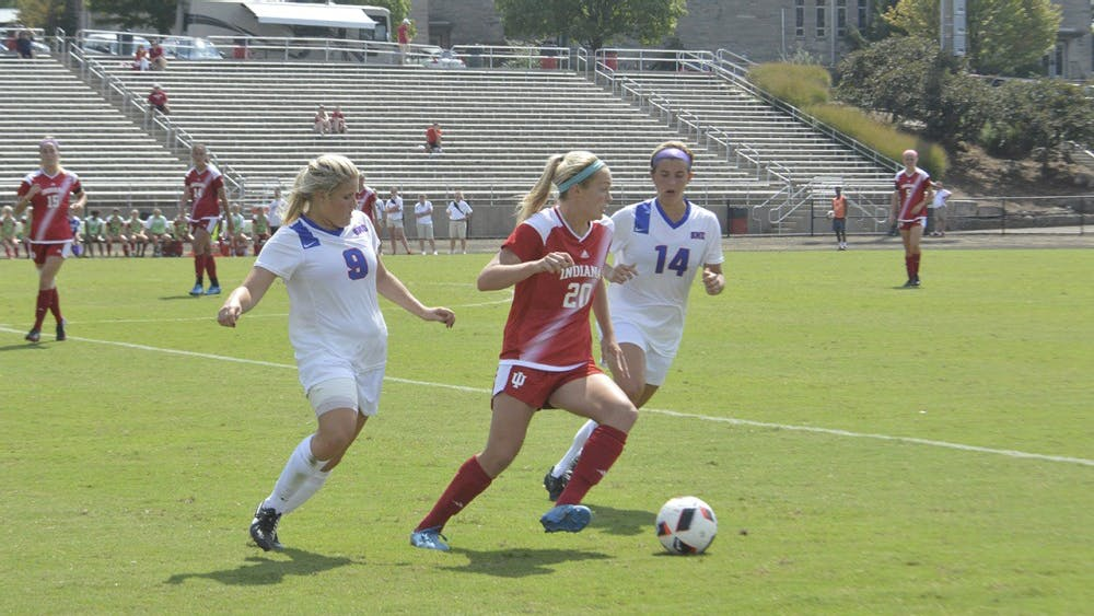 Caroline Dreher defends the ball against Southern Methodist University players during a match on Monday, September 5 at Bill Armstrong Stadium.