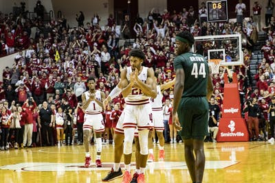 Redshirt-freshman forward Jerome Hunter claps as he is hugged by junior forward Justin Smith at the end of the second half against Michigan State on Jan. 23 in Simon Skjodt Assembly Hall. IU won 67-63.