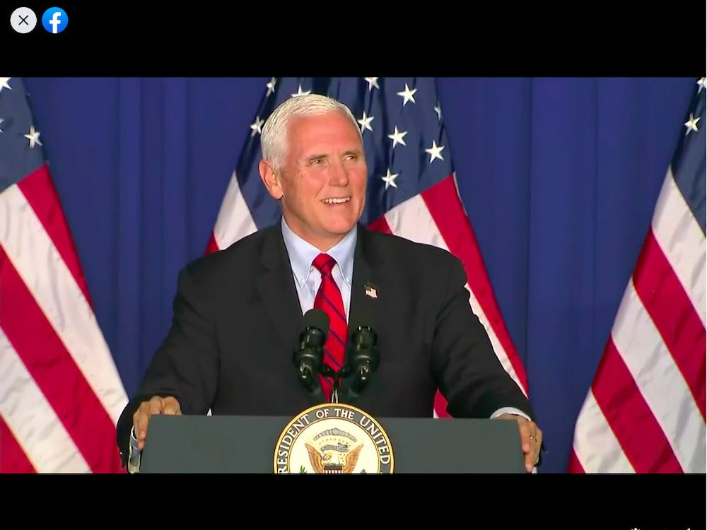 """Vice President Mike Pence speaks Thursday night during his """"Make America Great Again!"""" rally in Fort Wayne, Indiana."""