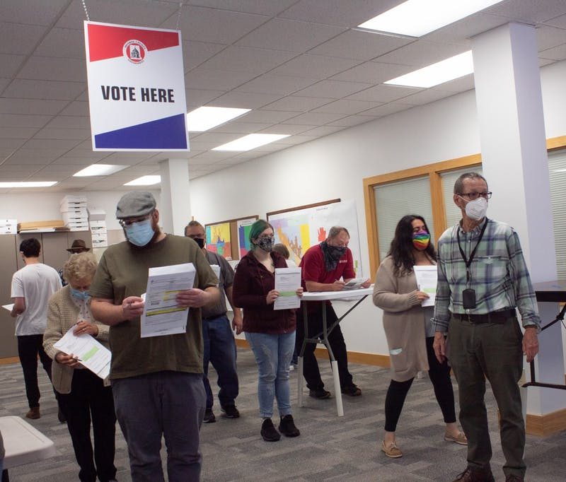 Voters wait in line to submit their ballots Oct. 6 at the 401 W. 7th St. The early voting period started in Indiana on Oct. 6.