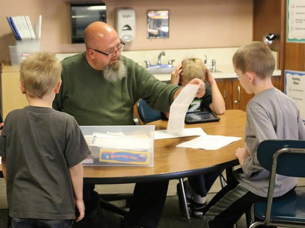 Special education teacher at Highland Park Elementary School Kraig Bushey works with students in the classroom on focusing skills to prepare them for traditional classrooms in the future.