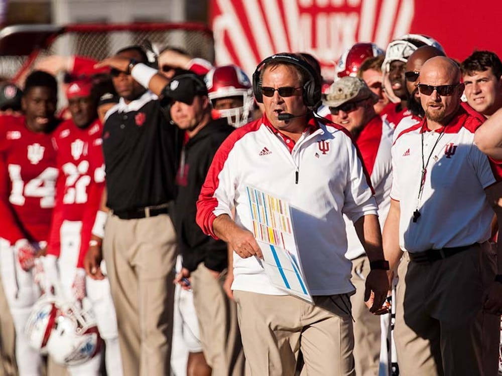 Head coach Kevin Wilson walks down the sideline as the Hoosiers make a play against Penn State during the second half on Saturday at Memorial Stadium.