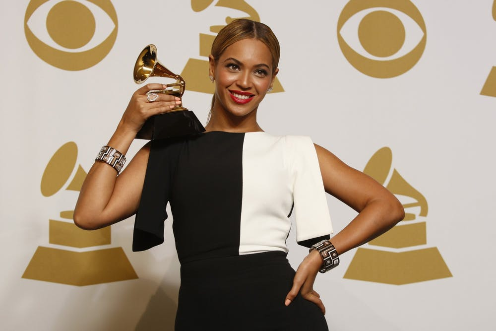 <p>Beyonce holds up her award on February 10, 2013, backstage at the 55th Annual Grammy Awards at the Staples Center in Los Angeles.</p>
