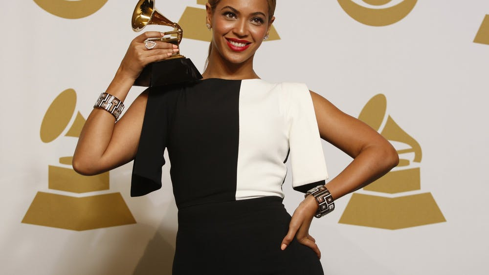 Beyonce holds up her award on February 10, 2013, backstage at the 55th Annual Grammy Awards at the Staples Center in Los Angeles.