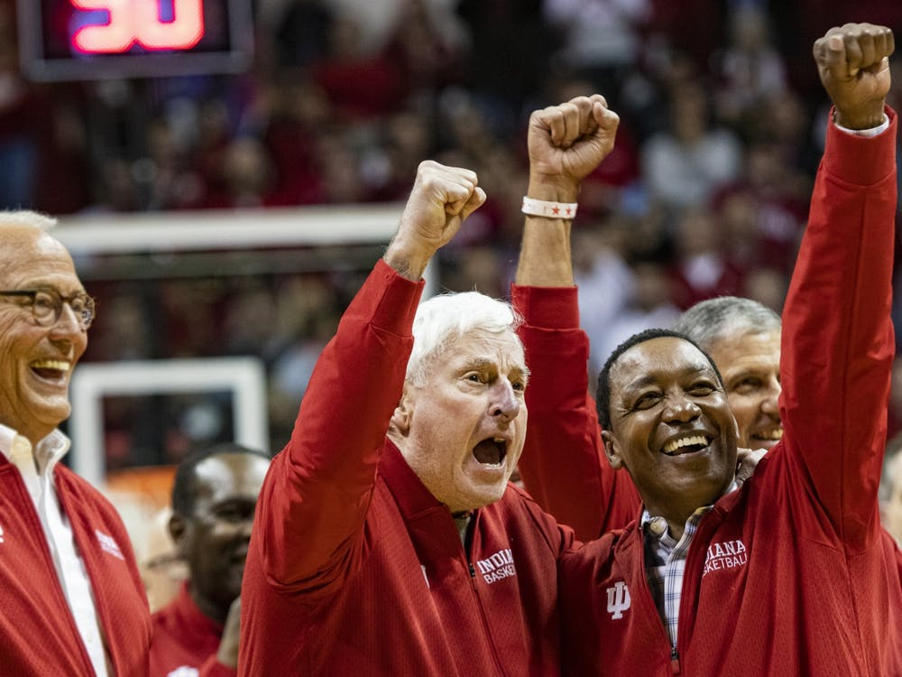 "Former IU men's basketball head coach Bob Knight puts his fist in the air with former IU men's basketball player Isiah Thomas at halftime Feb. 8 in Simon Skjodt Assembly Hall. Sophomore Matt Cohen received the Hearst Journalism Awards Program Personality/Profile Writing award Friday for his feature on Bob Knight, ""The General comes home."""