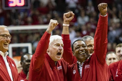 """Former IU men's basketball head coach Bob Knight puts his fist in the air with former IU men's basketball player Isiah Thomas at halftime Feb. 8 in Simon Skjodt Assembly Hall. Sophomore Matt Cohen received the Hearst Journalism Awards Program Personality/Profile Writing award Friday for his feature on Bob Knight, """"The General comes home."""""""
