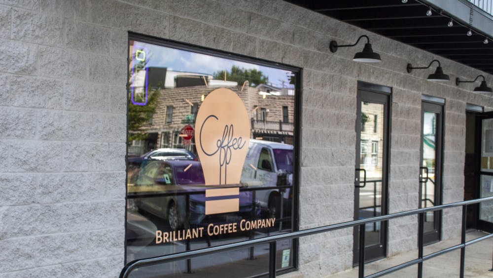 The window for the Brilliant Coffee Company is pictured Aug. 26 at 217 W. 6th St. The coffee shop serves crafted coffee beverages as well as gelato.