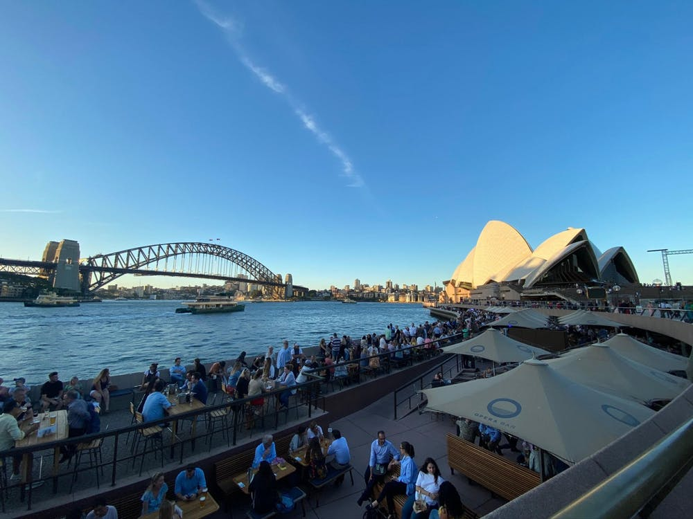 The sun sets at the Sydney Opera House on March 13, 2020.