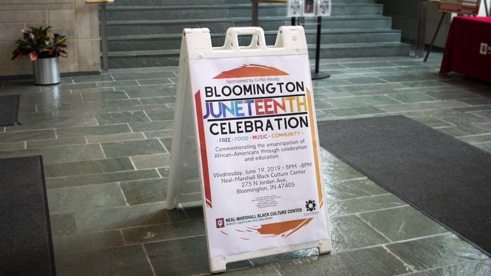 A Bloomington Juneteenth Celebration sign stands June 19, 2019, in the entrance in the Neal-Marshall Black Cultural Center.