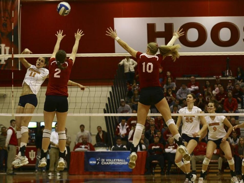 A Tennessee attack gets through blockers Jordan Haverly and Ashley Benson on Saturday in University Gym. The Hoosiers played two five-set games this weekend to advance to the NCAA tournament's Sweet 16.