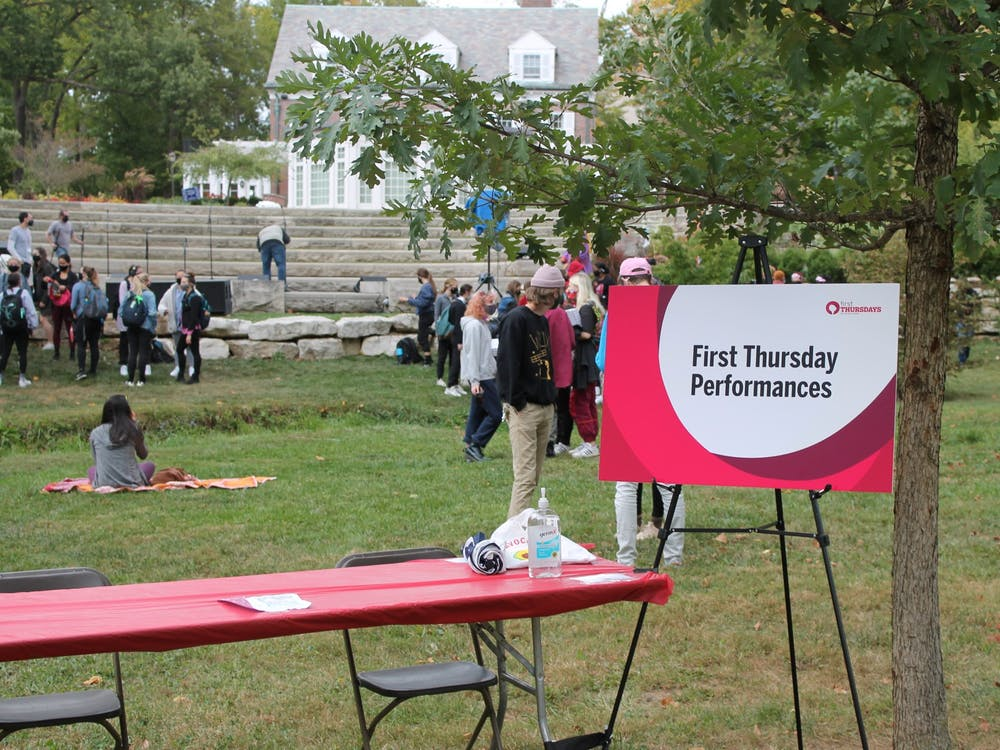 Students gather near the President's House Oct. 1 for First Thursdays. The monthly First Thursdays celebrations are still happening despite the COVID-19 pandemic, but are now more spread out to comply with social distancing guidelines.