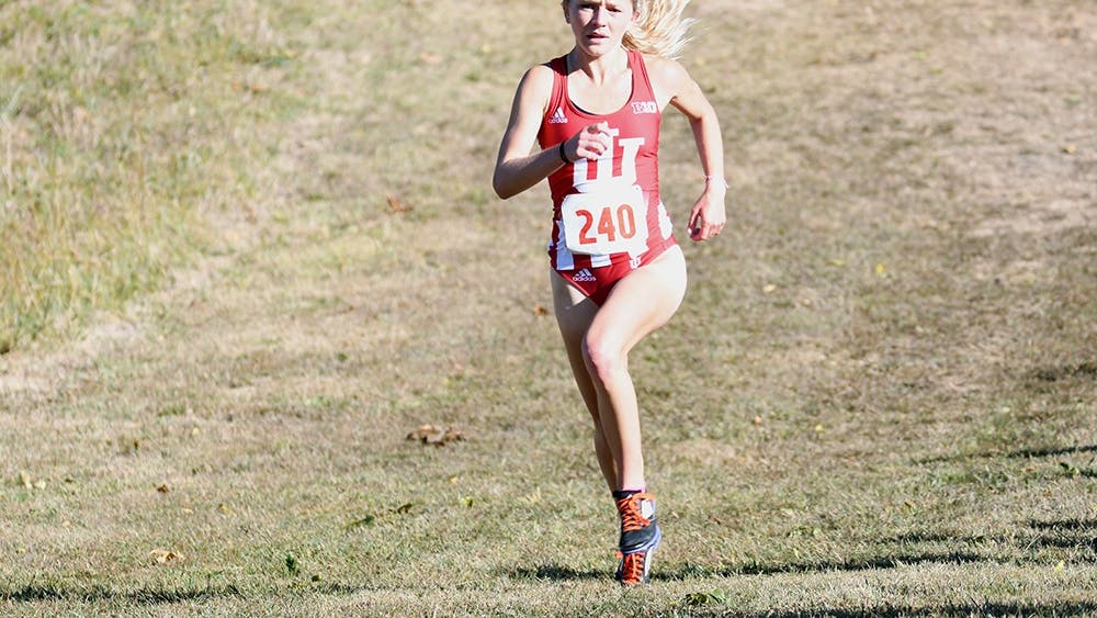 Junior Katherine Receveur runs during the Sam Bell Invitational on Sept. 30, 2017, at the IU Championship Cross Country Course.