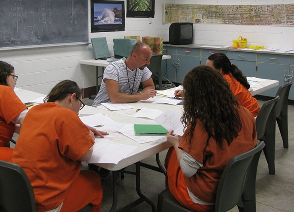<p>Chris Harmon, a volunteer workshop instructor at New Leaf - New Life, leads a reentry workshop inside the Monroe County Correctional Center. New Leaf – New Life is a nonprofit who supports people incarcerated and recently released from the Monroe County jail.</p>