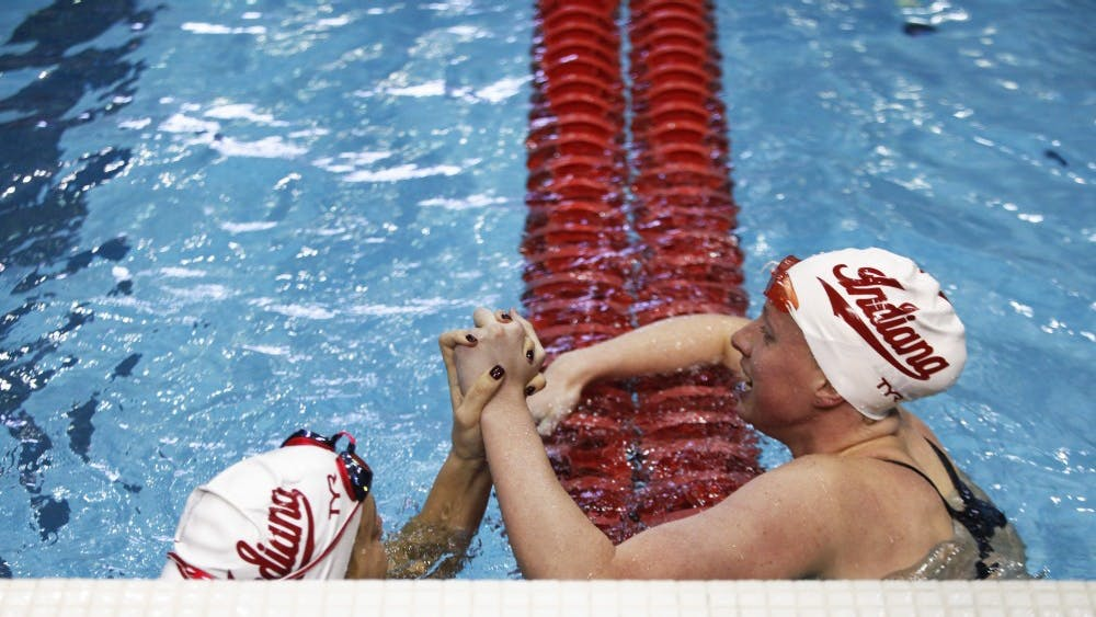 Senior Lilly King and freshman Noelle Peplowski celebrate after placing first and second Nov. 17 at Counsilman Billingsley Aquatic Center. IU beat Purdue 187.5-111.5 on Jan. 25.