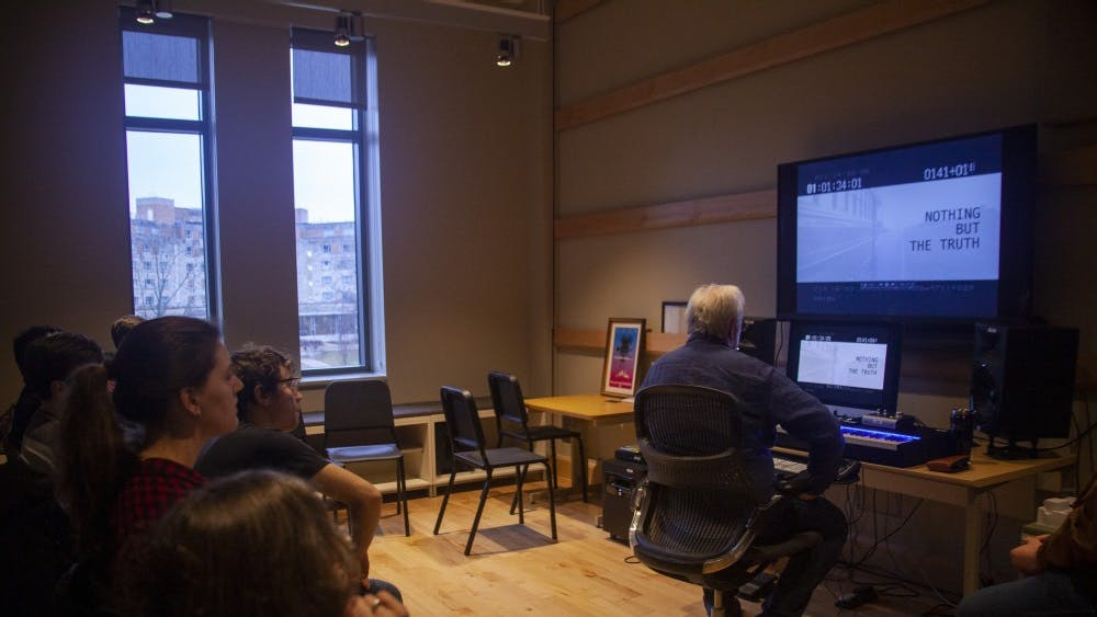 Professor Larry Groupé and his class watches a clip a student has worked  Feb. 7 in the East Studio Building. This class gives students the chance to practice creating a film scores for films.