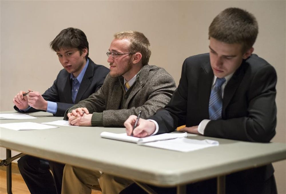 IUSA presidential candidate Sidney Fletcher sits with SPARC running mates Jonathan Hawkins and Ty Nocita Thursday evening at the IUSA Debate in the Fine Arts Building. The debate enabled candidates to introduce themselves to the voting public and debate issues such as campus saftey, university budget, and student rights.