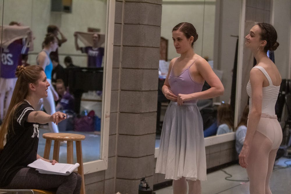 <p>Professor Carla Körbes gives corrections to senior Haley Baker and junior Lily Bines on March 13 in the Musical Arts Center. Baker and Bines were both cast as Cinderella in the now-canceled spring ballet. </p>