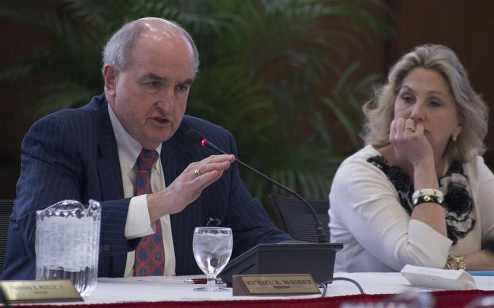 <p>IU President Michael McRobbie introduces a presentation at the Board of Trustees Academic Meeting April 10, 2014, at Franklin Hall. McRobbie plans to step down in June, and a search committee to find his replacement has begun interviewing candidates. </p>