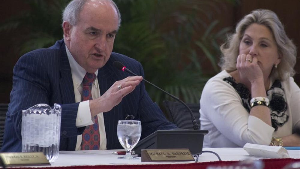 IU President Michael McRobbie introduces a presentation at the Board of Trustees Academic Meeting April 10, 2014, at Franklin Hall. McRobbie plans to step down in June, and a search committee to find his replacement has begun interviewing candidates.