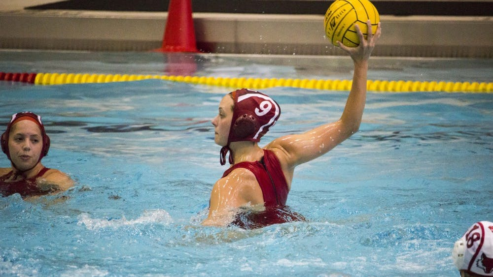 Attacker Sarah Myers throws the ball to a teammate against Marist College on March 4. The Hoosiers won 10-3 at the Councilman Billingsley Aquatics Center.