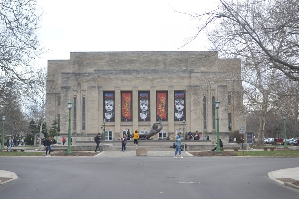 <p>People walk across the Fine Arts Plaza Jan. 23 in front of IU Auditorium. The IU Auditorium and IU Cinema have both canceled and postponed events due to the coronavirus pandemic. </p>