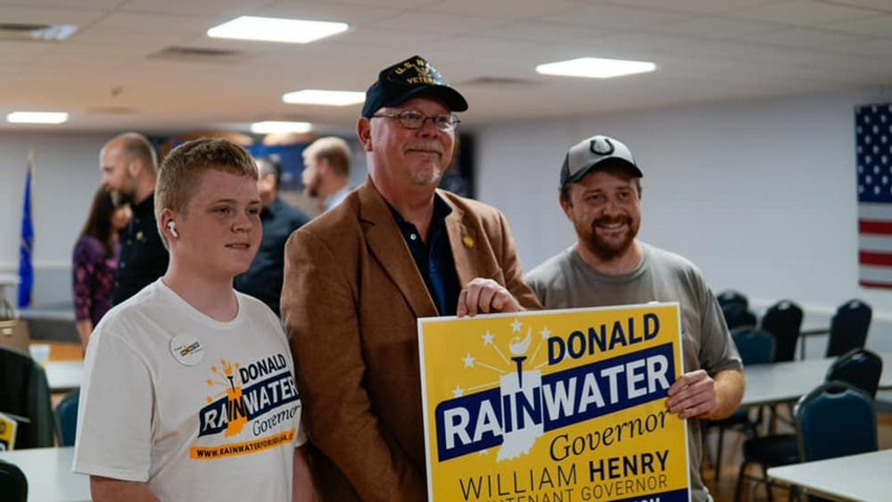<p>Indiana gubernatorial candidate Donald Rainwater poses with supporters at a campaign event. Rainwater is the Libertarian nominee for governor, competing against Republican incumbent Gov. Eric Holcomb and Democratic candidate Dr. Woody Myers.</p>