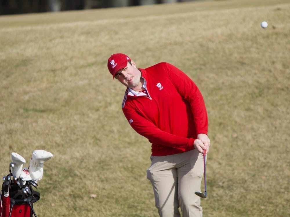 Then-senior golfer Brendon Doyle chips the ball onto the green during practice Feb. 1 at the IU Golf Course.