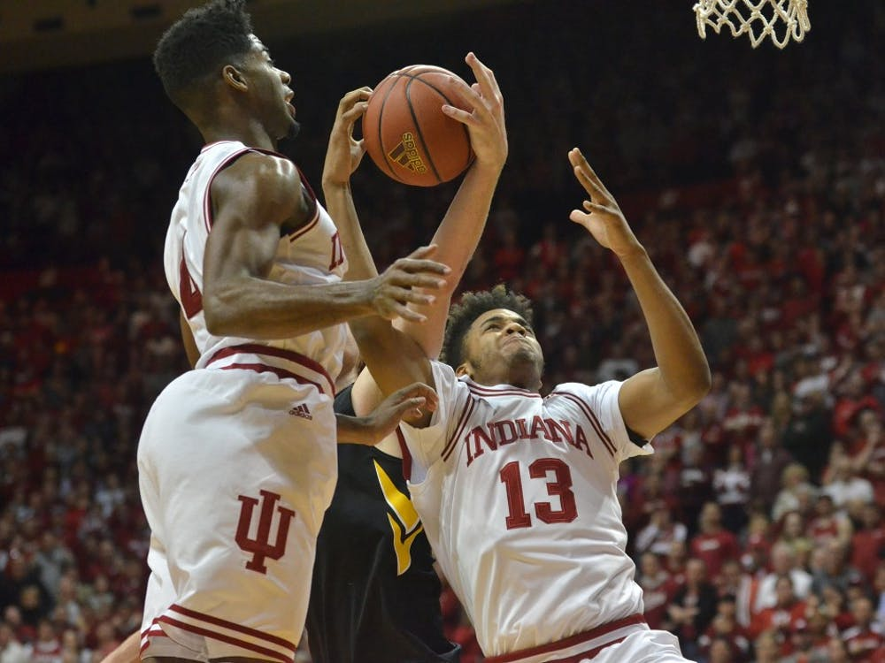 Then-freshman forward Juwan Morgan and then-sophomore guard Robert Johnson go up for a rebound against then-No. 4 Iowa in February 2016 at Simon Skjodt Assembly Hall, then known as Assembly Hall. The Hoosiers won 85-78.