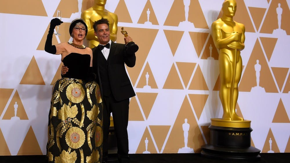 Foreign Language Film winner Sebastian Lelio and presenter Rita Moreno pose together backstage at the 90th Academy Awards on Sunday, March 4, 2018, at the Dolby Theatre in Hollywood.