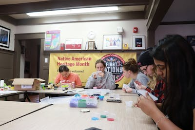 IU students create beaded keychains on Nov. 13 in the First Nations Educational and Cultural Center. The keychain workshop was held to promote Native American Heritage Month.