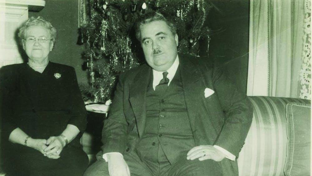 Herman B Wells with his mother, Anna Bernice Harting Wells, in the front room of Woodburn House about 1950.  Wells served IU in many capacities including as the Univeristy's 11th president and long-time chancellor.