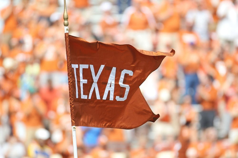 <p>A flag for the Texas Longhorns waves at Darrell K Royal-Texas Memorial Stadium on September 25, 2010 in Austin, Texas. The SEC's addition of Texas and the University of Oklahoma may force the Big Ten into added more schools.</p>