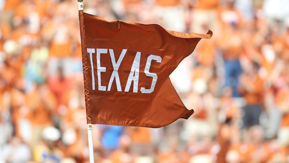 A flag for the Texas Longhorns waves at Darrell K Royal-Texas Memorial Stadium on September 25, 2010 in Austin, Texas. The SEC's addition of Texas and the University of Oklahoma may force the Big Ten into added more schools.