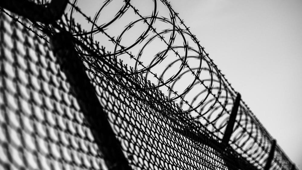 A prison fence is pictured. President Joe Biden signed an executive order Jan. 26 to to eliminate the use of privately operated criminal detention facilities.